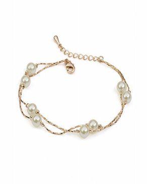 Dinardo Gold Plated Swarovski Bracelet with Pearl Stones logo