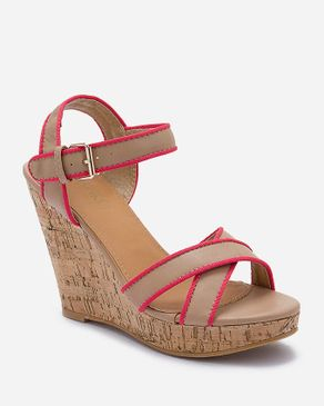 Zoom Nude Patent Leather Wedge Cross Sandals logo